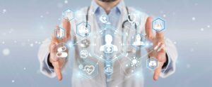 pic- Abstract of a network of Healthcare icons floating between a doctor's hands