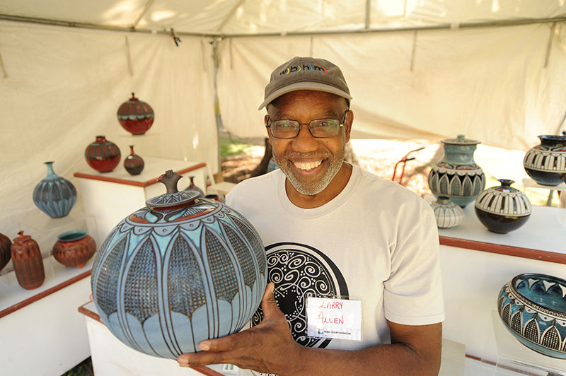 Larry Allen shows off his pottery work