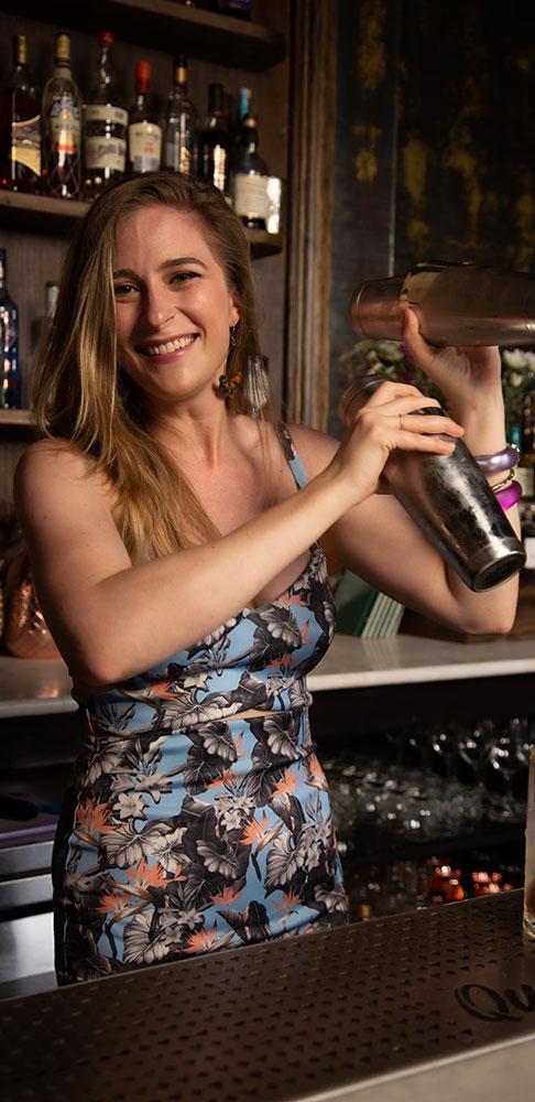 aura Newman mixes a drink at Queen's Park
