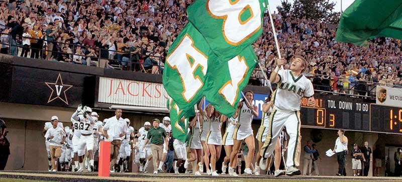 UAB Football cheerleaders enter the field