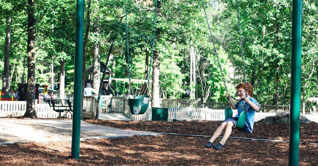 boy on a swing in a park