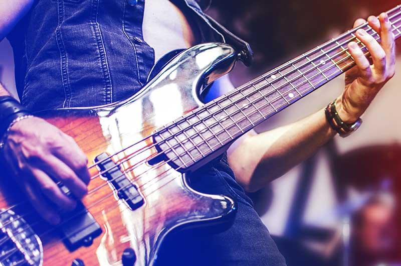closeup of man playing a guitar