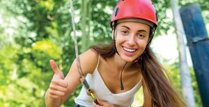 Woman ready to use the zip line at Red Mountain Park